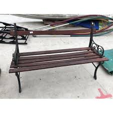 a vintage wooden garden bench with cast