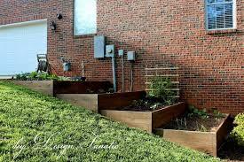 terraced raised beds sloped garden