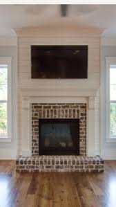 brick and shiplap fireplace and mantle
