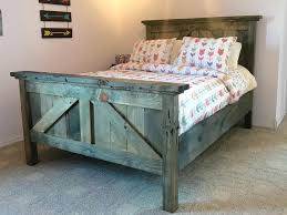 rustic farmhouse bedframe barndoor look