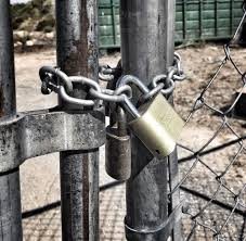 Gate Closed With Chain And Double Locks Stock Photo 32e7e6a6 9d5d 487f 9abf 8d50717b35ae