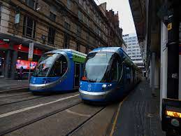 Pair of OLA West Midlansd Metro trams (24 and 27) at Grand… | Flickr