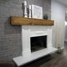 grey paint wash on a brick fireplace