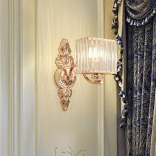 clear crystal wall sconce in rose gold