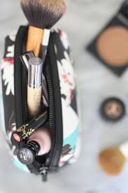 what s in my travel makeup bag treats