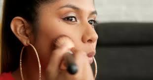 young woman creating a makeup tutorial