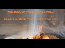 why is my woodstove smoking back into