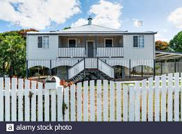 Old High Set House After Renovation Completed With New Fence Stock Photo Alamy