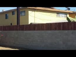 privacy fence on top of a block wall