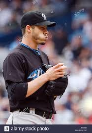 Toronto Blue Jays starting pitcher Dustin McGowan chews on his ...