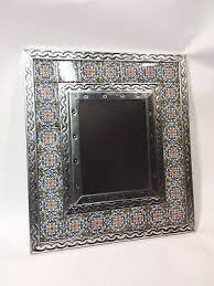 mexican tile and punched tin mirror