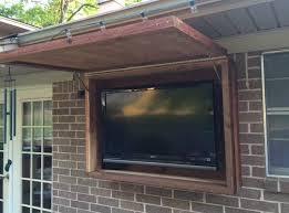 outdoor tv cabinet made of rough cedar