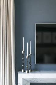 tv over art deco marble fireplace