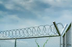 Premium Photo Prison Security Fence Barbed Wire Security Fence Razor Wire Jail Fence