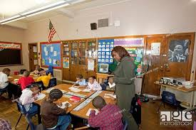 Detroit, Michigan - First grade teacher Ivy Bailey teaches a class at  MacDowell Elementary School, Stock Photo, Picture And Rights Managed Image.  Pic. X2J-1065249 | agefotostock