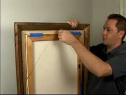 how to hang pictures with a wire hanger