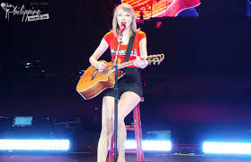 taylor swift in bright burning red in