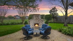 boasts patio with stone fireplace
