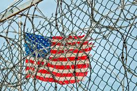 American Flag Behind Barbed Wire Fence Teenzone