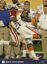 Oklahoma wide receiver Manuel Johnson (1) gets separated from the ball by  Gator safety Major Wright (21) in the first quarter of the 2009 FedEx BCS  National Championship NCAA football game in