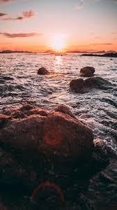 خلفيات غروب الشمس على البحر