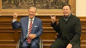 Gov. Greg Abbott and Elon Musk pose with uniquely Texas hand gesture