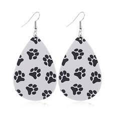 white faux leather dog paw print