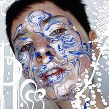 body art makeup artist uses faces as