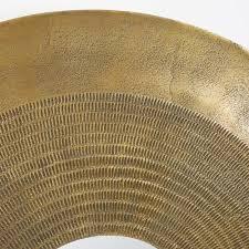 brass coloured hammered metal round