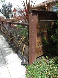 Modern Low Fence With Wood At Bottom Horizontal Wires And Nice Metal Details What I Love About This Fence Is Front Yard Fence Wood Fence Design Fence Design