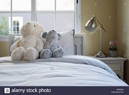 Kids Room With Dolls And Pillows On Bed And Bedside Table Lamp Stock Photo 147818796 Alamy