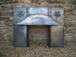crafts copper insert fireplace voysey