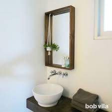 frame a bathroom mirror with a ledge