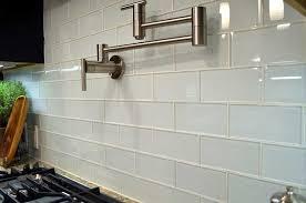 glass subway tile backsplash on kitchen