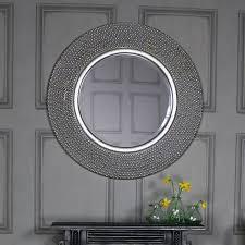 round glamorous silver wall mirror