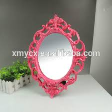oval bathroom mirror frame in rose red