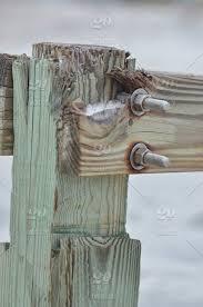 Fence Close Up Wood Wooden Nut Post Iron Screw Bolt Screws Stock Photo 76995e52 Cc93 4d63 B357 447d5a4069d6