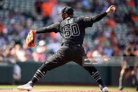 Mychal Givens of the Baltimore Orioles pitches during a baseball ...