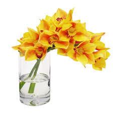 faux yellow orchid in glass vase