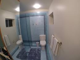 the shower has no curtains but only