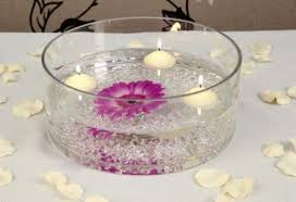 large clear round glass bowl by white