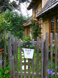 Wonderful Cottage Garden In Carmel I Love The Grape Stake Fence And Climbing Plants Ground Covers Cottage Garden Design Cottage Garden French Cottage Garden