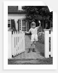1940s Boy Standing Near White Picket Fence Gate Waving Posters Prints By Corbis