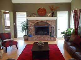 brick fireplace decor above chalkboard