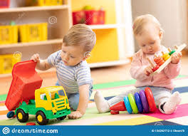 Kids Play With Educational Toys Children Sit On A Rug In A Play Room At Home Or Kindergarten Toddler Boy With Toy Stock Photo Image Of Game Cute 134262712