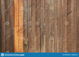 Dark Stained Wood Fence With Two Lighter Slats Stock Image Image Of Fence Divider 152794181