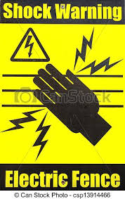 Shock Warning Warning Sign On An Electric Fence In Bright Yellow