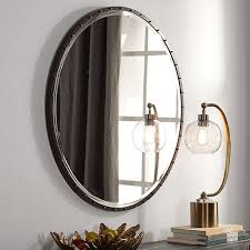 rustic black and gold round mirror