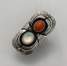 Mother of pearl and red coral ring by Ivan Howard engraver coral  motherofpearl ivanhoward oldstyle navajojewelr…   Coral ring, Stamped  jewelry, Engraved rings