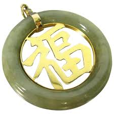 vintage 14k gold jade good luck pendant